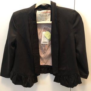 Black blazer with ruffle on the bottom
